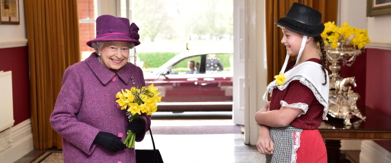 Ffion Williams presents a bunch of daffodils to Britain's Queen Elizabeth following a visit to the Royal Welsh Regiment at Lucknow Barracks to mark St David's Day, in Tidworth
