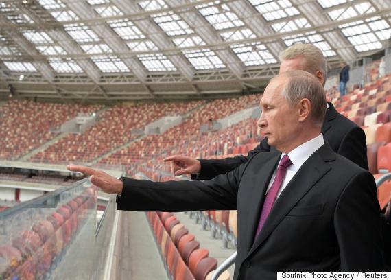 Russian President Vladimir Putin listens to Moscow Mayor Sergei Sobyanin as they inspect the Luzhniki Stadium in Moscow
