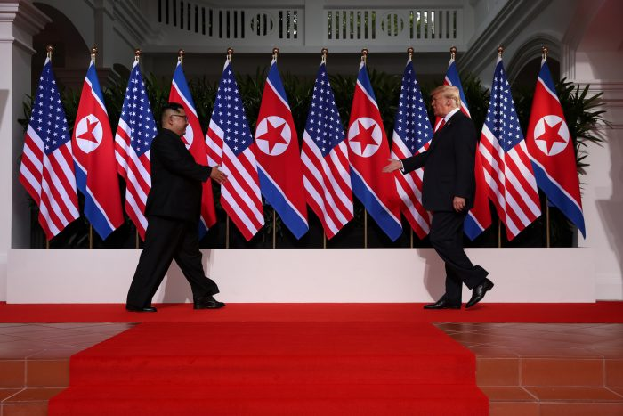 U.S. President Donald Trump and North Korean leader Kim Jong Un prepare to shake hands at the Capella Hotel on Sentosa island in Singapore